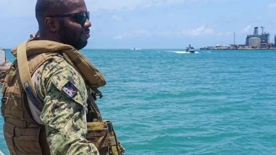 A member of Task Group (TG) 68.6 stands on security watch at the Port of Djibouti on May 4, 2018 (Image Credit: U.S. Navy/Carlos A. Monsalve)