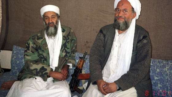 Al Qaeda leader Ayman al-Zawahiri (right) sits with the group's founder Osama bin Laden (left) during an interview with Pakistani journalist Hamid Mir (not pictured). (Image Credit: Hamid Mir/Wikimedia Commons)