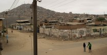Of Peru's forty-three districts, Villa María del Triunfo is one of the poorest in terms of income, access to health care, and infrastructure. Dios es amor's (DEA) main facility is located on this street, which lacks paved roads.