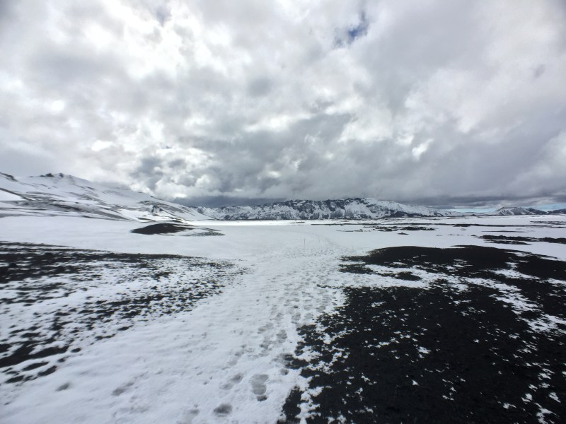 Snowfield and exposed lava rock, Askja, Highlands, Iceland
