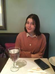 Nastya smiling despite our rude waiter