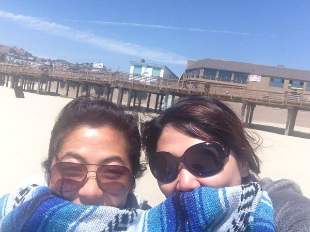 We were desperately trying to shield ourselves from the wind! :)