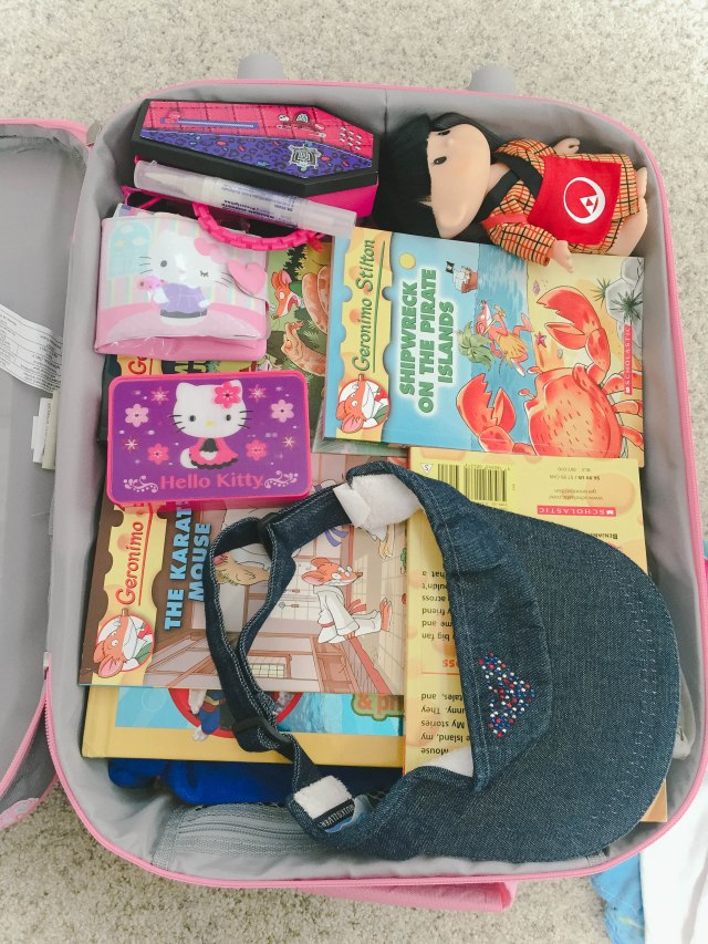 Bridgette has started packing for herself since she was about 6, and it's always very interesting to me to see what she packs in her little luggage. Apparently, lip gloss, toys, and books are more important than underwears and toothbrushes. :)