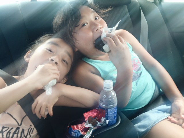 Back in the car eating spam masubi, so they were happy again. :)