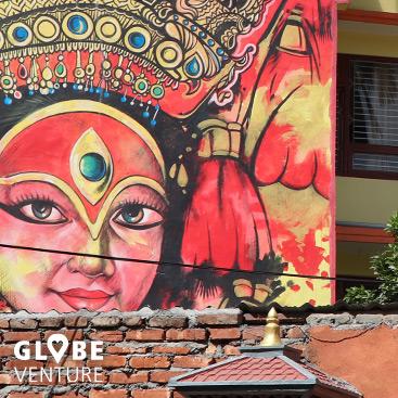 Streetart mit Portrait der Kumari Devi im Thamel Kathmandu
