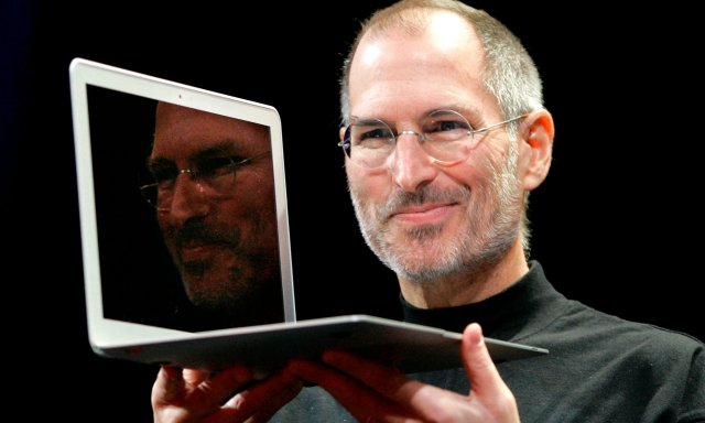 Steve Jobs holds up the MacBook Air at a conference in 2008.