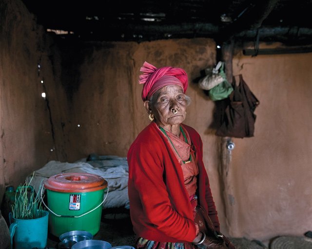 Phulmaya Tamang, 73, has to carry water because the only tap in the village doesn't have enough water.