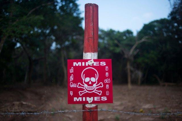 A sign warns of hidden landmines in Mullivaikal on the northeastern coast of Sri Lanka.