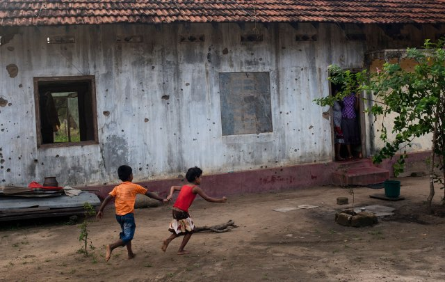 Children play outside their bullet-riddled home in Mullivaikal, which is where the final battle of Sri Lanka's civil war took place.