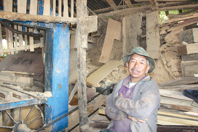 ENTREPRENEUR AT EPICENTRE: Resh Bahadur Ghale has been operating his saw mill non-stop since electricity was restored in Barpak in April, making doors and windows for the reconstruction of village houses.