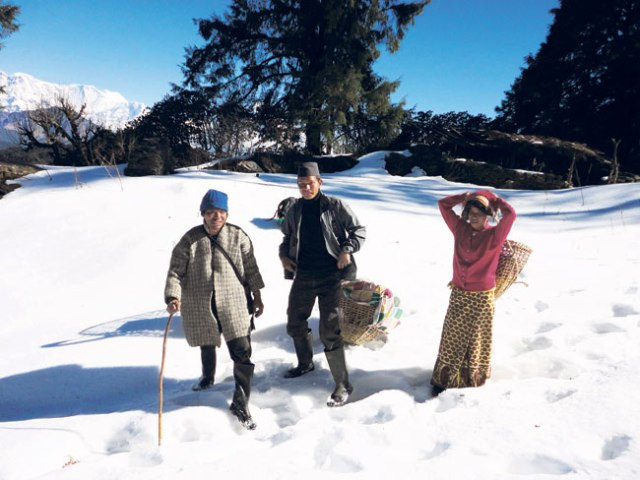 Local people enjoying the snow fall at Gurja VDC.