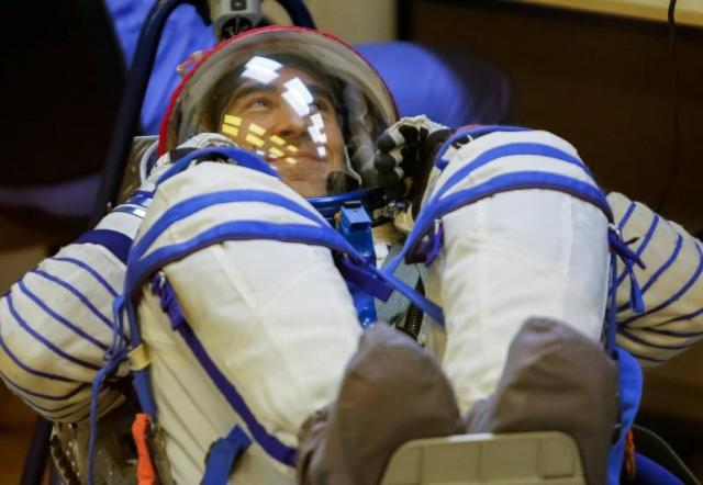 The International Space Station (ISS) crew member Anatoly Ivanishin of Russia looks on during his space suit check at the Baikonur cosmodrome, Kazakhstan, July 7, 2016. REUTERS/Shamil Zhumatov