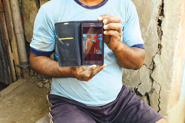 BUILDING LIVES: Ram's son Raghu, a migrant worker in Doha, lives in a camp with 9,200 others and shares his room with seven Nepali workers. His family has built a house with the money he sent back home.
