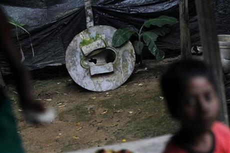 In this May 30, 2016 photo, a broken toilet seat stands in the backyard of a house in Bormi village, near Dhaka, Bangladesh. Through a dogged campaign to build toilets and educate Bangladeshis about the dangers of open defecation, the densely populated South Asian nation has managed to reduce the number of people who defecate in the open to just 1 percent of the 166 million population, according to the government, down from 43 percent in 2003.