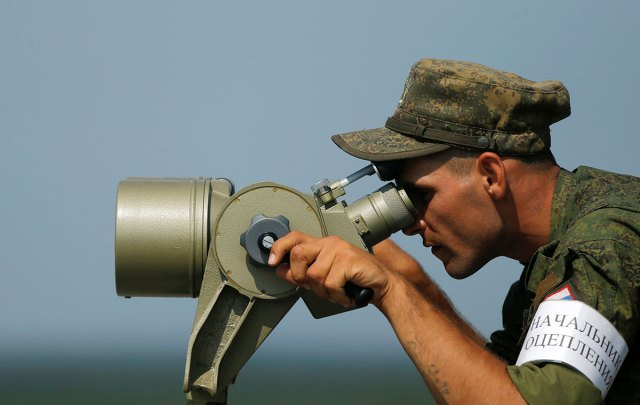 A Russian servicemen uses binoculars during a competition of the International Army Games 2016 at a range in the settlement of Alabino outside of Moscow.