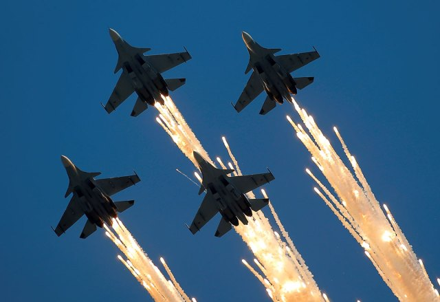 Sukhoi Su-30SM jet fighters of the Sokoly Rossii (Falcons of Russia) aerobatic team fly in formation during the International Army Games 2016 in Dubrovichi outside Ryazan, Russia.