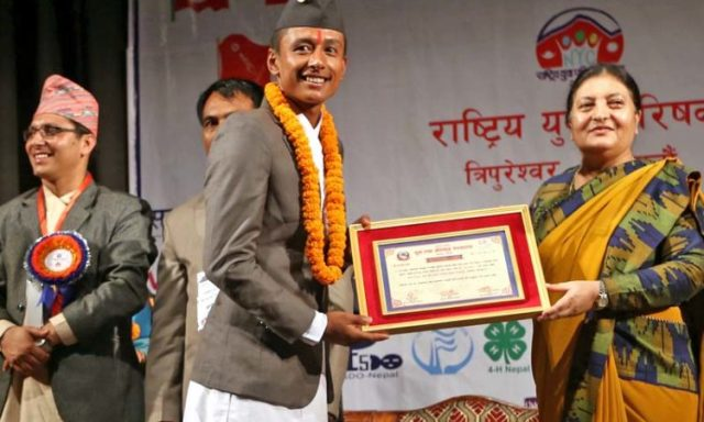 President Bidya Devi Bhandari honours star footballer, Nawyug Shrestha, amid a programme organised by the National Youth Council on the occasion on International Youth Day, in Kathmandu, on Friday, August 12, 2016. Photo: RSS