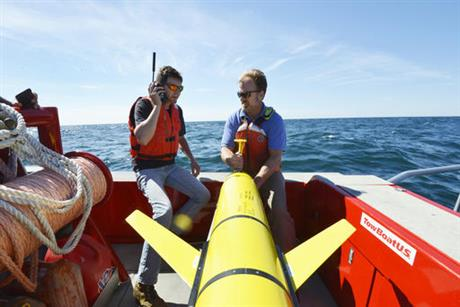 In this Sept. 2, 2016 photo, Woods Hole Oceanographic Institution engineers Patrick Deane, left, and Sean Whelan prepare to release a Slocum glider into the waters south of Martha's Vineyard, Mass. to monitor anticipated changes in the ocean during the passage of tropical storm Hermine. The underwater drones, or gliders as they are known, collect data that scientists say will help them better understand what sustains and strengthens hurricanes and tropical storms.