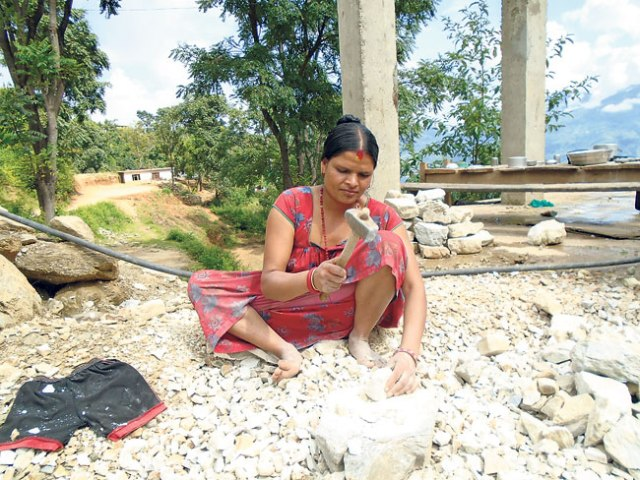 Mansara Bhat eking out a living by crushing stones for construction. (Sushila)