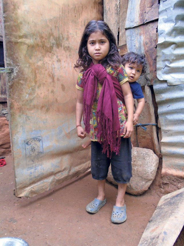 A little girl carries her brother in Mangalsen, Achham. (Asmita)