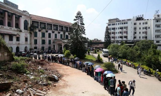 People are seen standing in a queue outside the Nepal Rastriya Bank to exchange old notes with new ones for Dashain festival, in Thapathali of Kathmandu, on Sunday, October 2, 2016. Photo: RSS