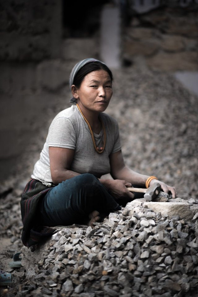 Surrounded by shingle, Chhiring begins the task of rebuilding her house in Thulo Shyaphru