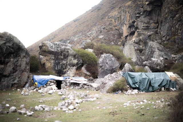 Temporary shelters in front of the caves south of Kyanjin Gompa have provided refuge