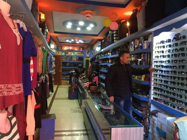Dipak Bikram Shahi sells designer clothing and branded accessories in Jumla.