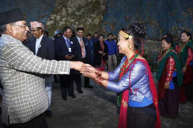 Prime Minister Puspa Kamal Dahal dancing during Chandragiri Cabal car officialy launching ceremony at Chandragiri Hill, Kathmandu on Thursday. POST PHOTO/PRAKASH CHANDRA TIMILSENA