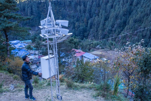 Nang Thume Sherpa, member of glacier lake task force, shows the early warning system installed in Fakding village, Solukhumbu. The early warning system will send automated messages from from a sensor installed in Imja lake.