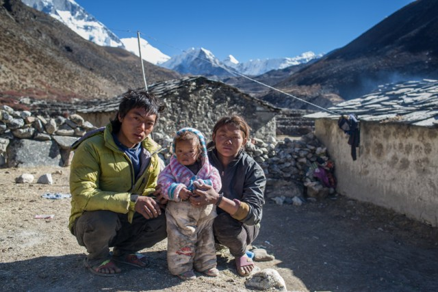 """Ajit Rai and his wife Ranjita Rai work as labourers in Dengboche village between Imja glacier and Everest Base Camp. """"Last year a small flash flood triggered from Lotse glacier that mixed with Imja rive. Although it only destroyed one bridge near Dengboche, it has made me to think more about the safety of my family,"""" said Ajit."""