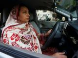 Aasia Abdul Aziz, one of the pioneer women drivers of Careem, drives her car in Karachi, Pakistan December 6, 2016.  REUTERS/Akhtar Soomro