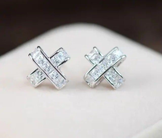 Pair Of Glamourous Womens Rhinestone Embellished Cross Shape Earrings