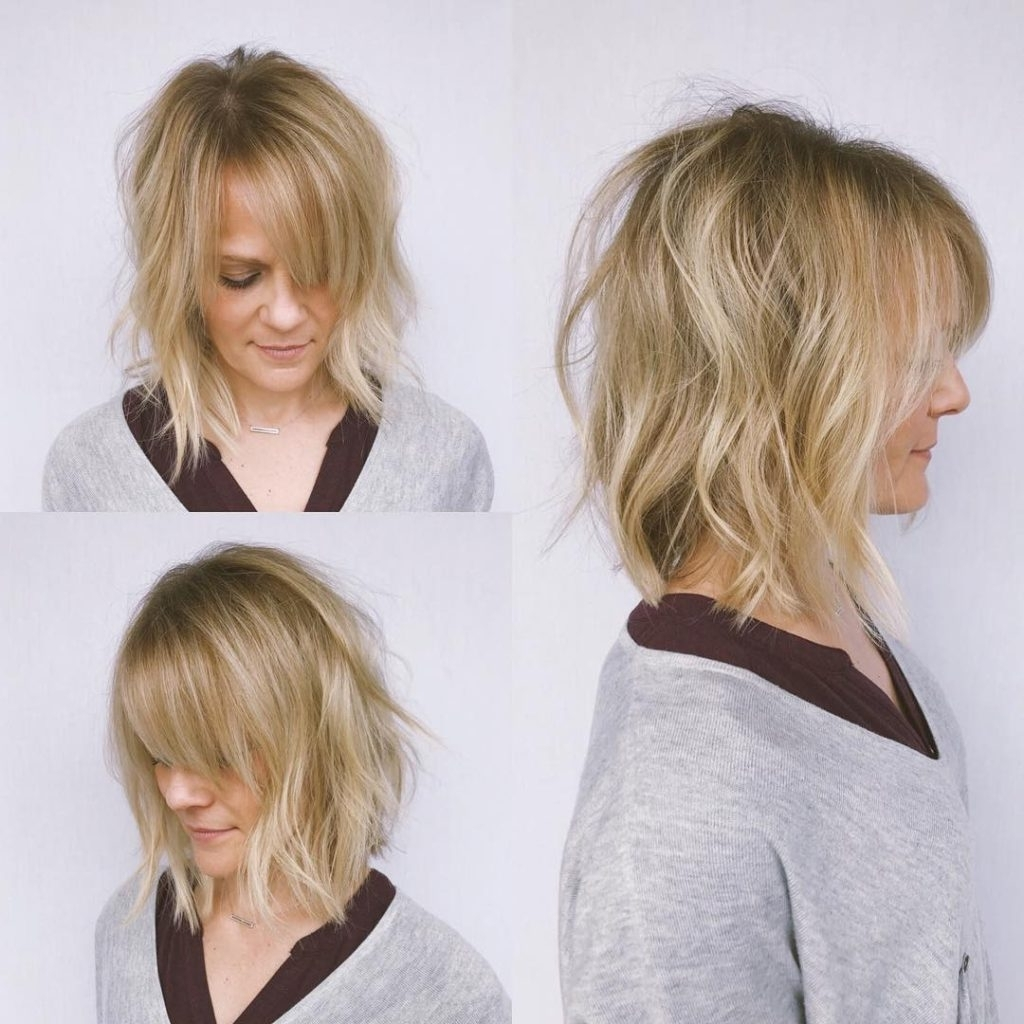 Undone Wavy Textured Bob With Parted Side Swept Bangs And Medium Wavy Hairstyles With Side Bangs