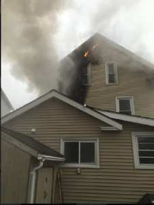 Gloucester Fire Department Battles Building Fire on Grove Street