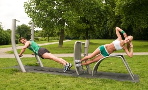 Outdoor Gym Equipment in use, (you too canb look like this if you donate)