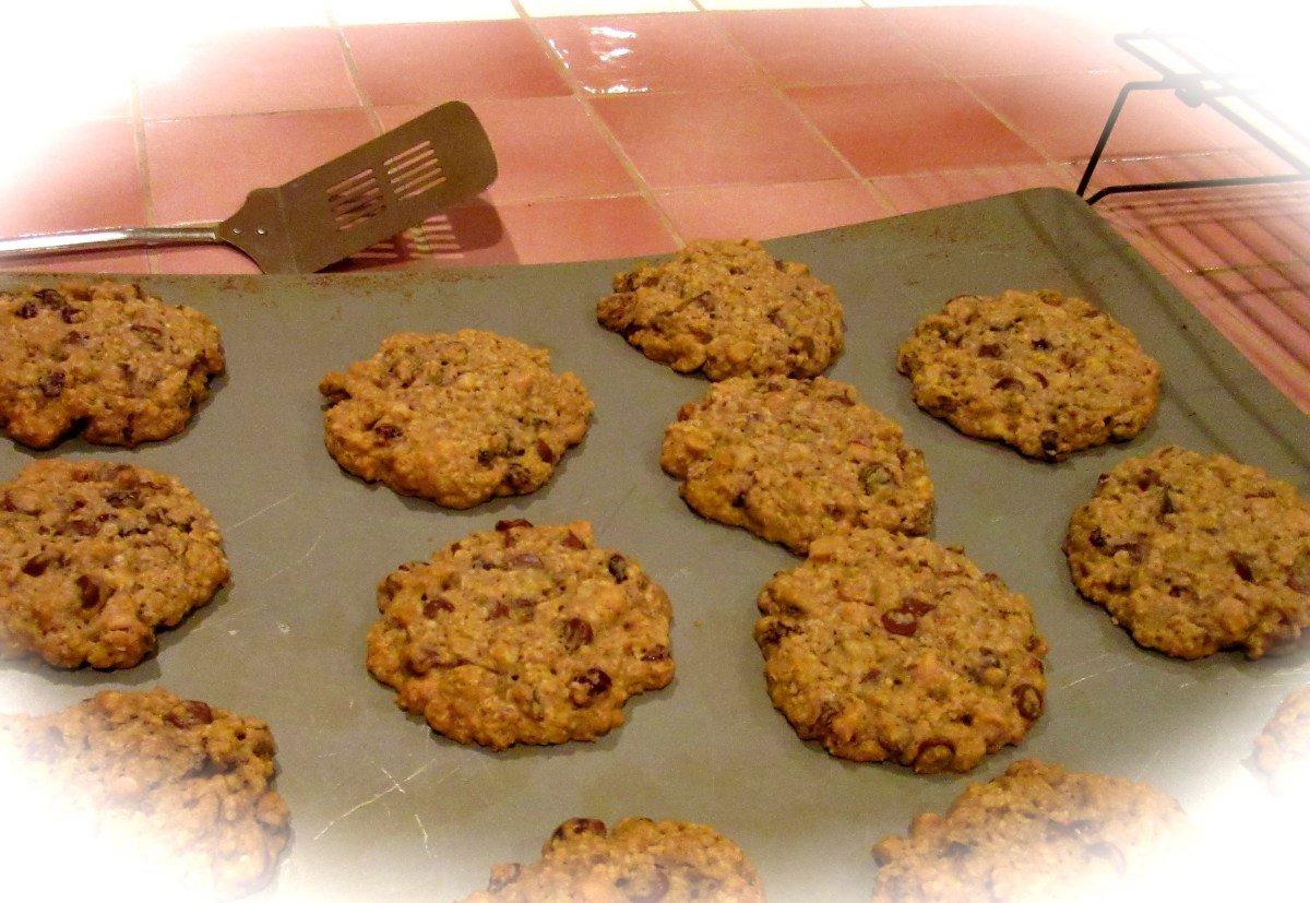Giant oatmeal-chocolate chip-everything cookies on a baking sheet