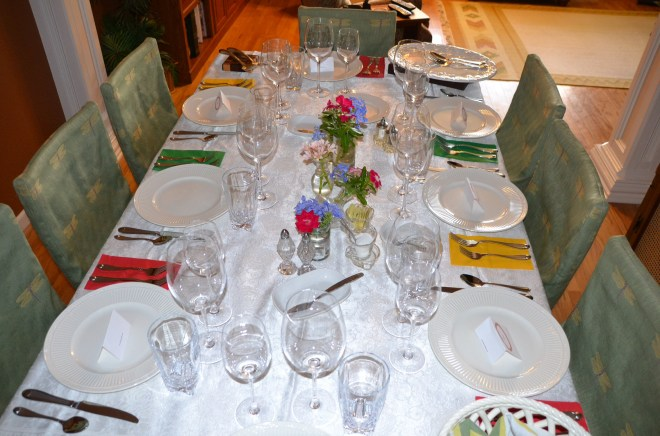 The small dining room is intimate and welcoming with the white linen and sparkly crystal