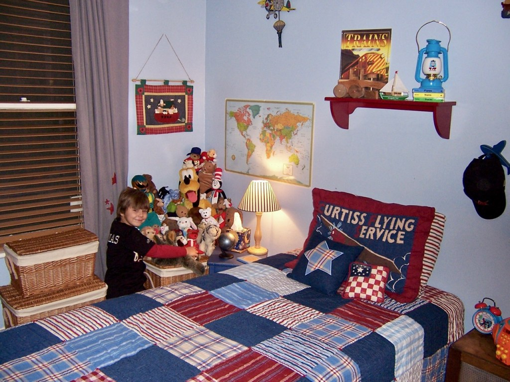 Little boy in cute room with stuffed animals