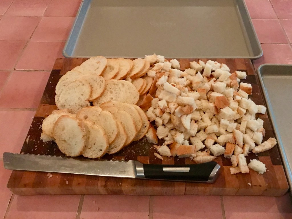 Sliced and cubed bread on a cutting board