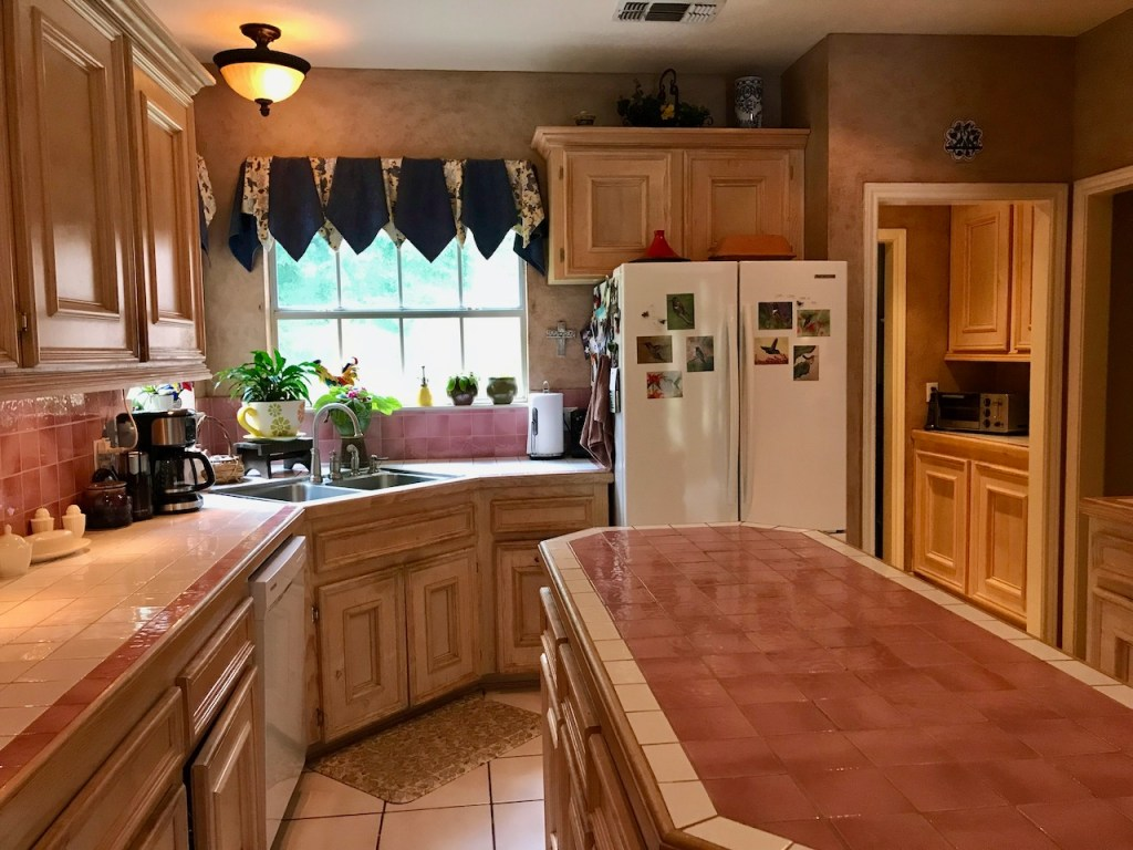 Outdated Pink Tile Island Kitchen