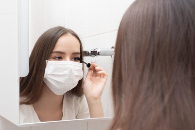 life-quarantine-coronovirus-woman-medical-mask-does-makeup-mascaras-her-eyes-disease-prevention-protection-165545-154.jpg