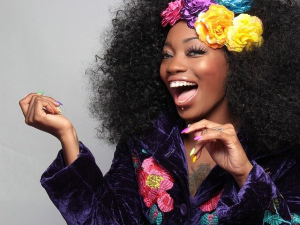 woman smiling happy natural hair