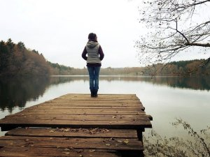woman thinking standing at dock