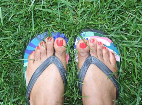 floral flip flops on model