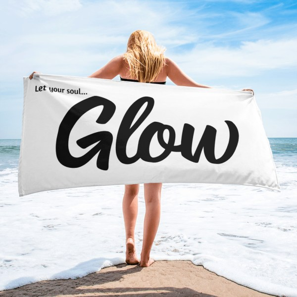 glow beach towel with model