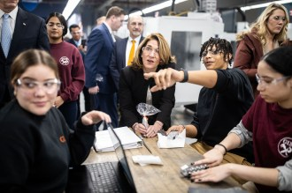 Lt. Gov. Karyn Polito, center, speaks with Robert Soler, a senior studying machine technology at Greater Lawrence Tech. (Courtesy Photo Greater Lawrence Tech)