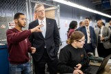 From left: Darwin Belliard, a senior studying machine technology at Greater Lawrence Tech; Gov. Charlie Baker; and Alexandra Villarroel, a senior studying machine technology at Greater Lawrence Tech. (Courtesy Photo Greater Lawrence Tech)