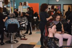 Students provided hair styles and manicures for women from the LARE Institute. (Photo courtesy of the Greater Lawrence Technical School)