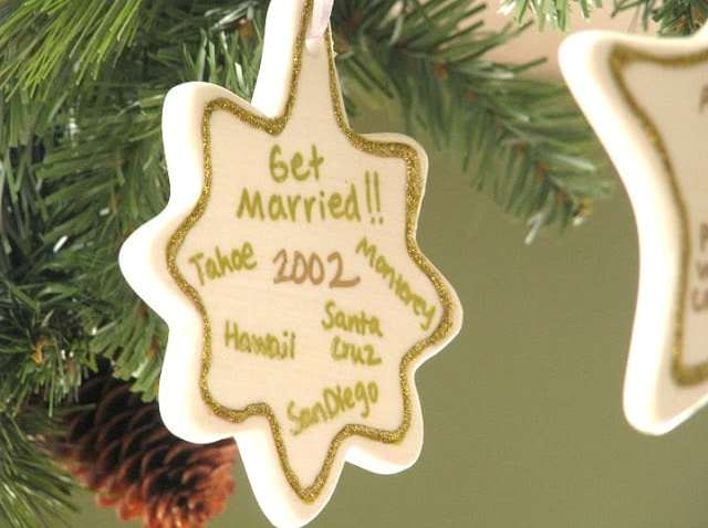 white ceramic ornament with date written on it